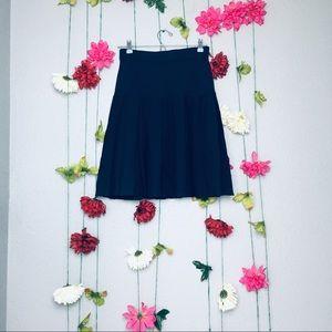 St. John Basic Navy Blue knit pleated skirt size 4